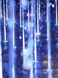 Blurred motion of the fountain blue color light for background abstract effect. Water stock photography