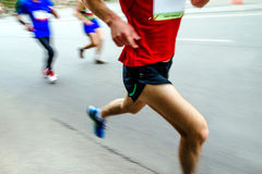 blurred motion group men runners Royalty Free Stock Image