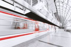 Blurred Motion of Illuminated Railroad Station in City Stock Photo
