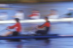 Blurred motion image of rowers Stock Images