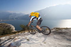 Blurred motion mountainbike downhill. Very fast downhill biker on garda lake Royalty Free Stock Photo