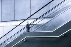 Blurred motion of one person on escalator. Blurred motion of one person on escalator with copy space Stock Photo