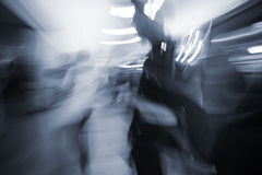 Blurred motion people commuting in the underground station walkw Stock Photos