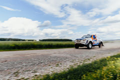 Blurred motion rally car driving on gravel road. Russia - July 10, 2017: blurred motion rally car driving on gravel road during Silk way rally Royalty Free Stock Photos