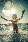 Blurred motion silhouette of child in the sea Royalty Free Stock Photos