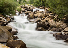 Blurred motion simple shot of mountain river Stock Images