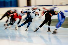 Blurred motion skaters compete in men mass start. Chelyabinsk, Russia - November 14, 2017: blurred motion skaters compete in men mass start during Cup in speed Stock Image