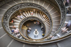 Blurred motion of tourists descending the Bramante staircase ins Royalty Free Stock Photos