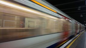 Blurred Motion of Train at Railroad Station Stock Images
