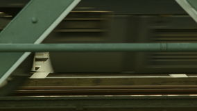 Blurred motion of a train on a railway bridge. Extraordinary view of modern transportation on railway bridge. Angles, steel, metal, great combination of modern stock video