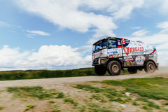 Blurred motion truck rally car Renault driving blue sky over him Royalty Free Stock Images