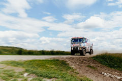blurred motion truck rally car Renault driving on dust road Stock Photography