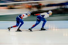 Blurred motion two men speed skaters to warm up Royalty Free Stock Photography