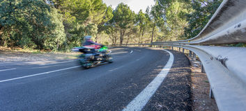 Blurred motorbike on curve Stock Photography
