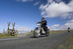 Blurred motorbikes on scenic road Stock Image