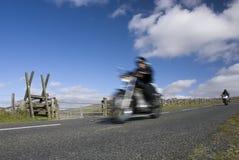 Blurred motorbikes on scenic road. Dartmoor, Devon, UK Stock Image