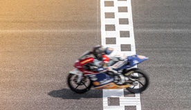 Blurred motorcycle on track royalty free stock images