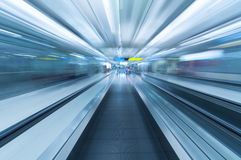 Blurred movement along airport walkway Stock Images