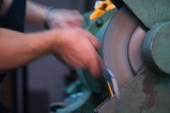 Blurred movement of blacksmith polishing Royalty Free Stock Photo