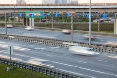 Blurred movement of vehicles on the four-lane highway, summer day Stock Photos