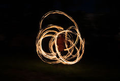 Blurred moving fire in the dark Royalty Free Stock Images