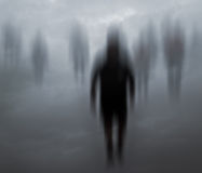 Blurred mysterious people walking Royalty Free Stock Photos
