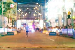 Blurred Night marathon runner. Sport background Stock Photo