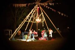 Blurred the night party with light And a small music stage. Concept adventure and sport outside Royalty Free Stock Photo