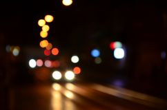 Free Blurred Night Scene Of Traffic On The Roadway. Defocused Image Of Cars Traveling With Luminous Headlights. Bokeh Art Royalty Free Stock Photo - 117270165