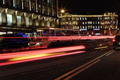 Blurred night traffic. Light trails on the road at night on Kamennoostrovskiy prospect in Saint-Petersburg, Russia. Blurred night traffic. Light trails on the Royalty Free Stock Photography