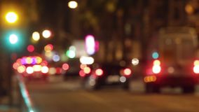Blurred night traffic scene with traffic light changes. stock video