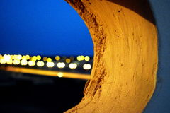 Blurred Nighttime City Lights Through Hole Royalty Free Stock Photography