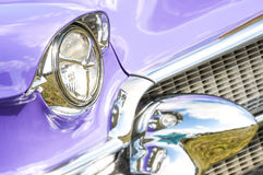 Blurred nostalgia. 1950s classic car headlight and grille with blurred chrome reflections Stock Photos