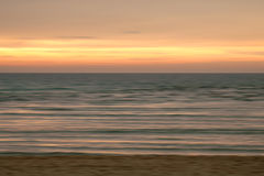 Blurred ocean. Beach landscape at sunset Royalty Free Stock Image