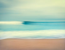 Blurred Ocean Wave. An abstract seascape with blurred panning motion.  Image displays a retro, vintage look with cross-processed colors Royalty Free Stock Images
