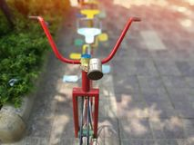 Blurred old bicycles for children to play and exercise stock photography