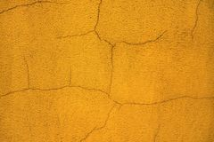 Blurred old scratched orange plastered house wall. Close up Royalty Free Stock Photography