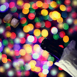 Opening festive events. Blurred outlines of the bottle and cork on a background of colored lights stock image