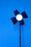 Blurred outlines of lighting monoblock on blue background. Photographic Equipment for photo shoots stock images