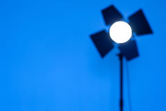 Blurred outlines of lighting monoblock on blue background. Photographic Equipment for photo shoots stock image