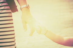 Blurred of parent holds the hand  a baby walking Royalty Free Stock Photos