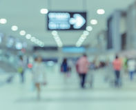 Blurred passengers in airport background Stock Image