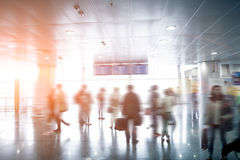 Blurred passengers looking at airport schedule at sunny day Royalty Free Stock Image