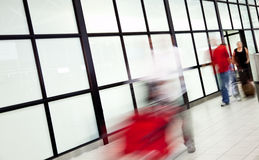 Blurred passingers airport Royalty Free Stock Image