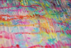 Blurred pastel hues, muddy watercolor abstract colorful background, gold texture. Hard sparkling golden red strokes of brush and muddy spots are placed on Royalty Free Stock Images