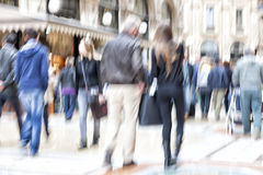 Blurred pedestrian in the city, zoom effect, motion blur. People walking in the city, rush hour, zoom effect, motion blur Royalty Free Stock Photos