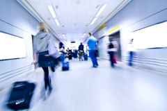 Blurred people on airport stock photography