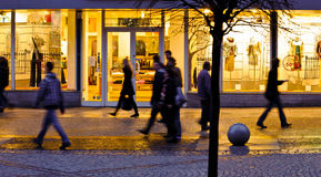 Blurred people in the city. In the evening Royalty Free Stock Images