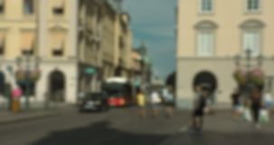 Blurred people crossing the street and hanging out at Stortorget, Linköping. stock video footage
