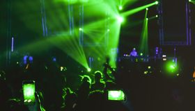 Blurred people dancing at music night festival event party Royalty Free Stock Images